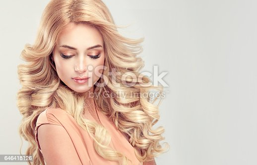 697916070istockphoto Attractive woman blonde with elegant hairstyle. 646418126