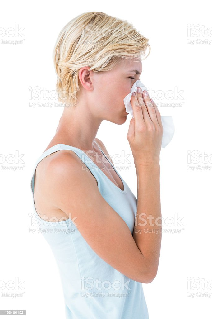 Attractive woman blowing her nose stock photo