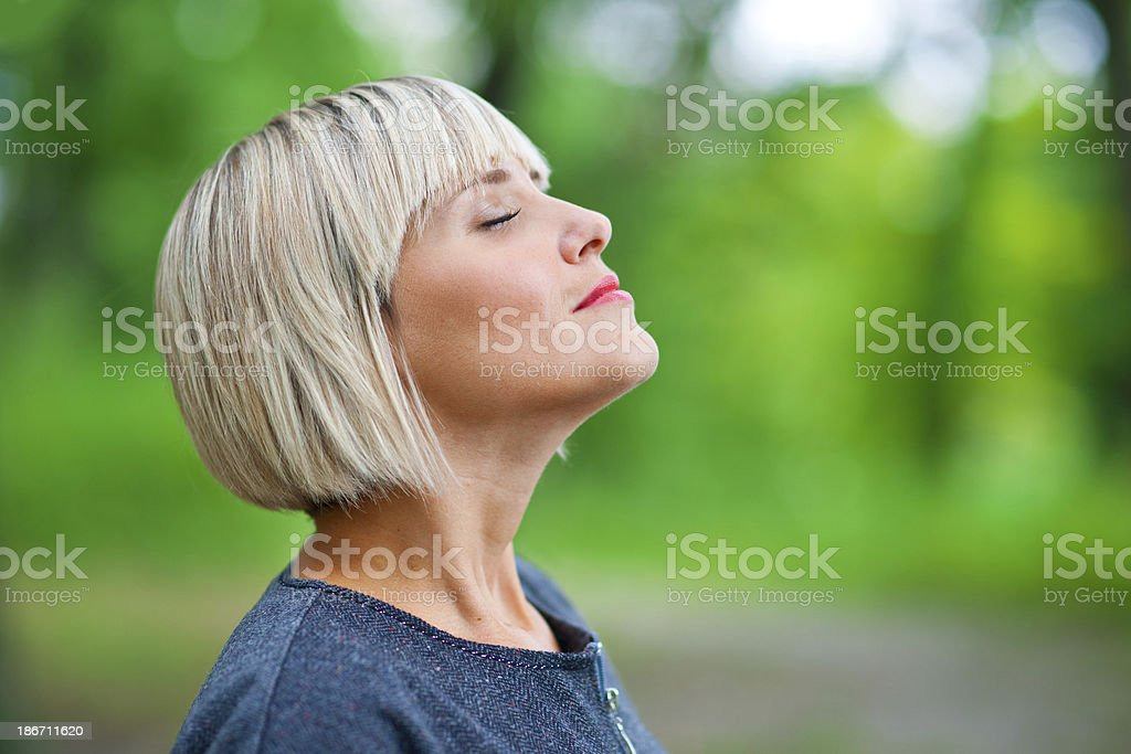 attractive woman breathing and relaxing attractive blond woman breathing and relaxing in nature Adult Stock Photo