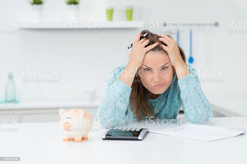 attractive woman calculating houshold costs stock photo