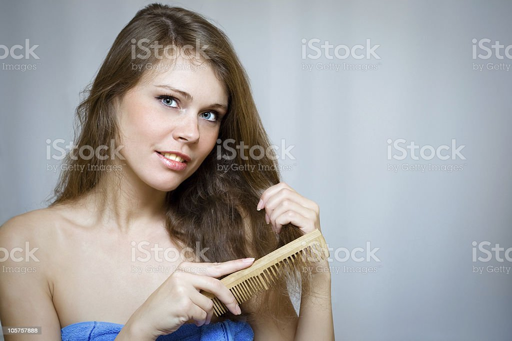 Attractive woman combing her hair royalty-free stock photo