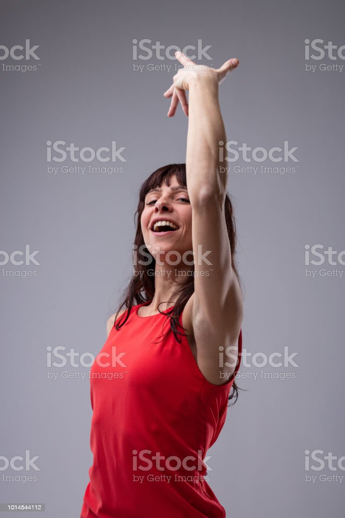 Attractive woman dancing and singing stock photo