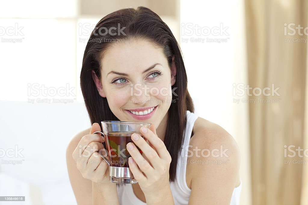 Attractive woman drinking tea stock photo