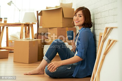istock Attractive Woman Enjoying New Apartment 818705472