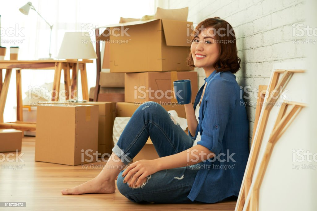 Attractive Woman Enjoying New Apartment stock photo