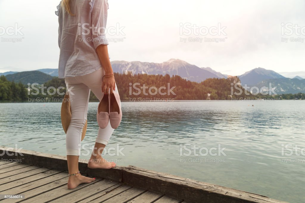 Attractive woman enjoying on the lake. stock photo
