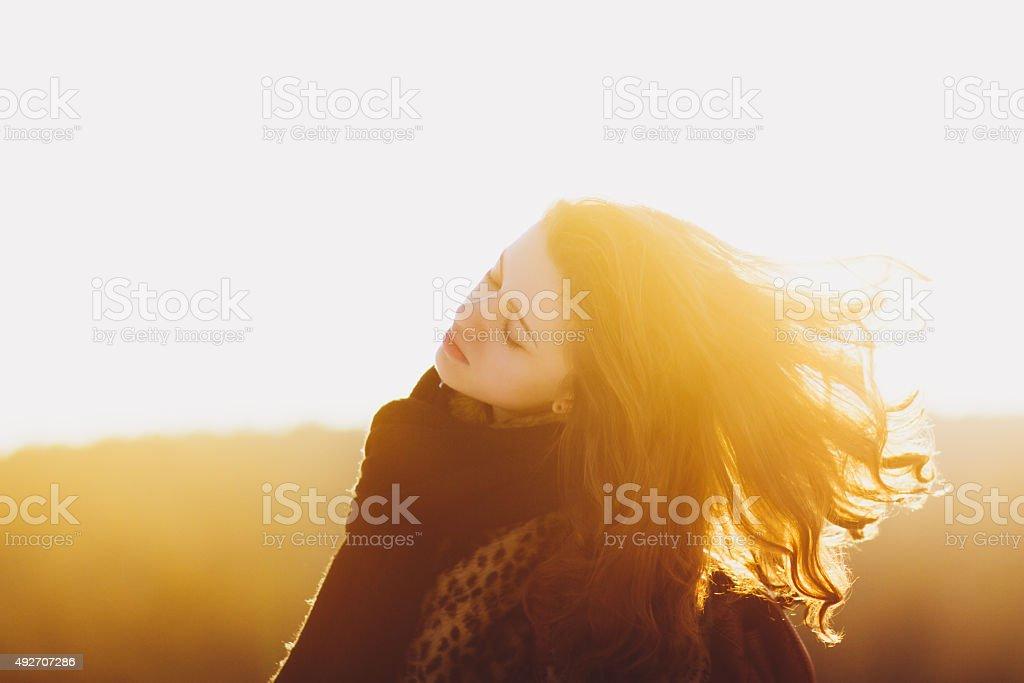 Attractive woman enjoying sunlight stock photo