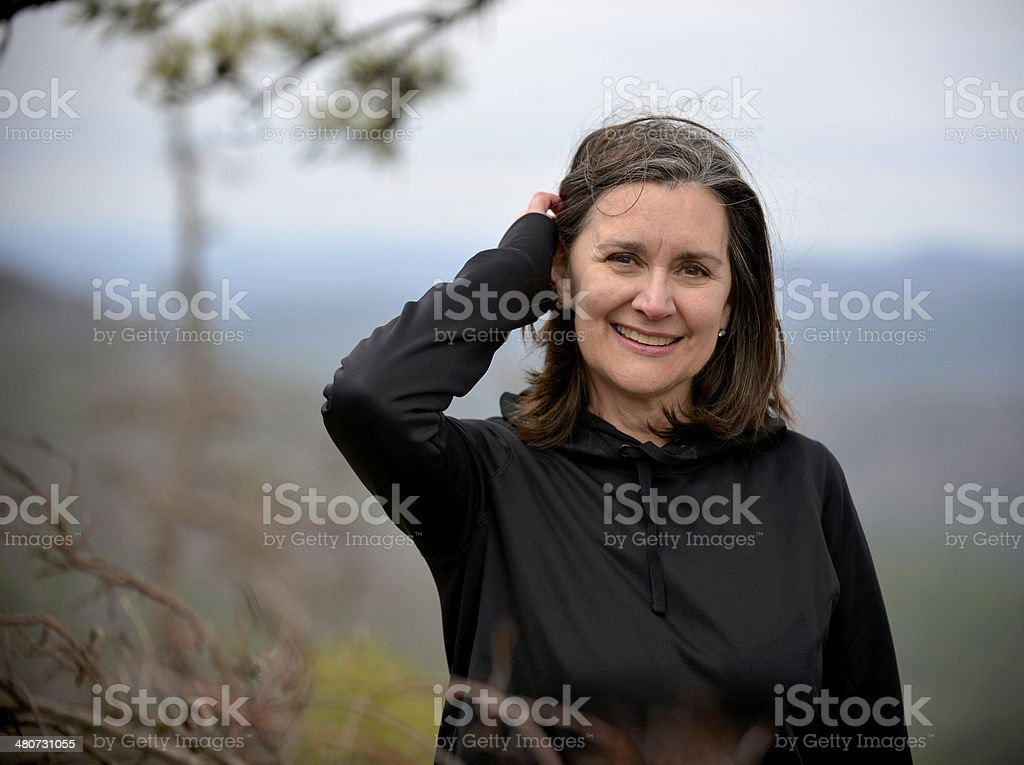 Attractive Woman Enjoying the Outdoors stock photo
