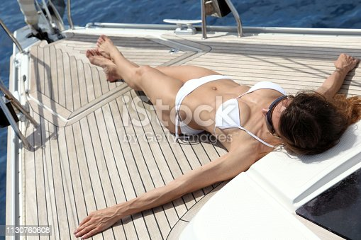Attractive woman enjoys sailing in Croatia