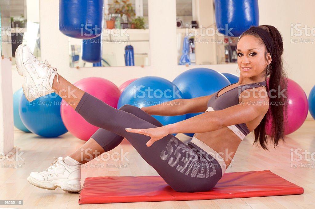 Attractive woman exercising in gym royalty-free stock photo