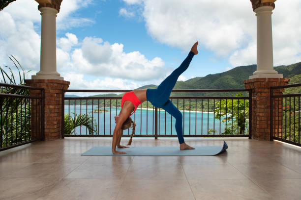 attractive woman exercising  on a private deck at a luxury villa