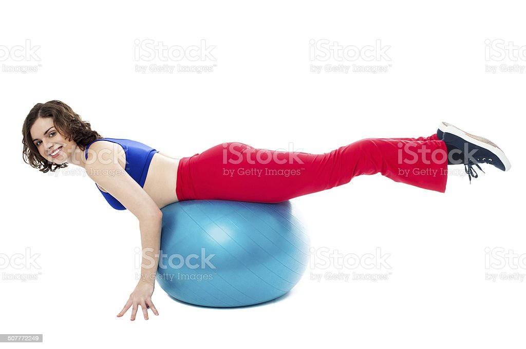 Attractive woman exercising with swiss ball stock photo