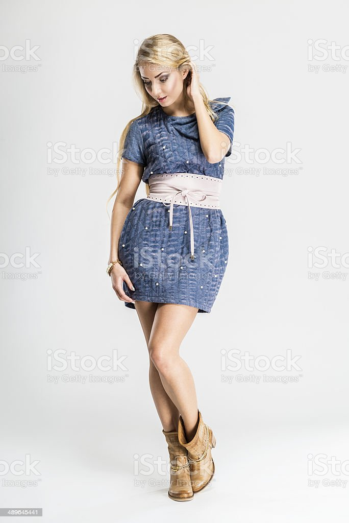 Attractive woman, fashion model wears fashionable summer sleeved jeans dress stock photo