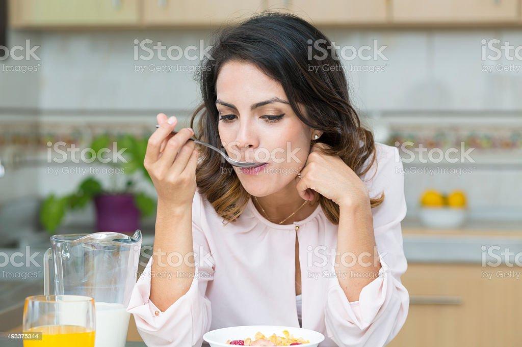 Attractive woman having breakfast stock photo