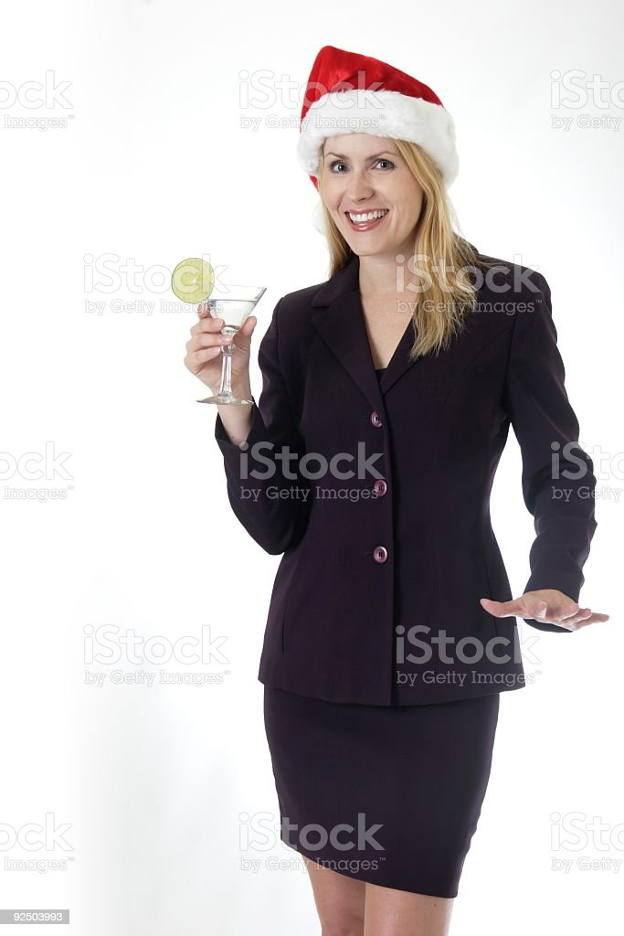 Attractive woman holding a martini at office Christmas party royalty-free stock photo
