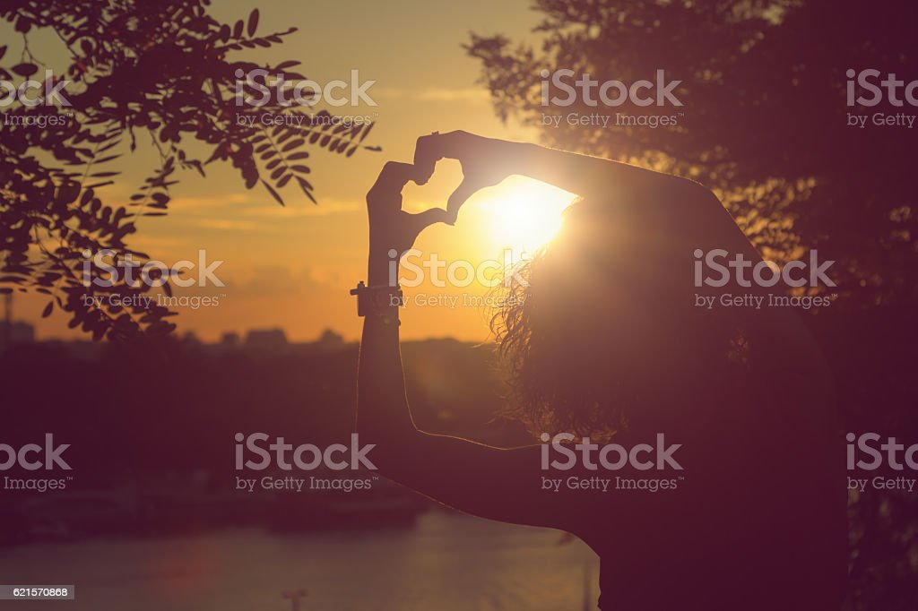 Attractive woman holding heart shape symbol for nature. photo libre de droits