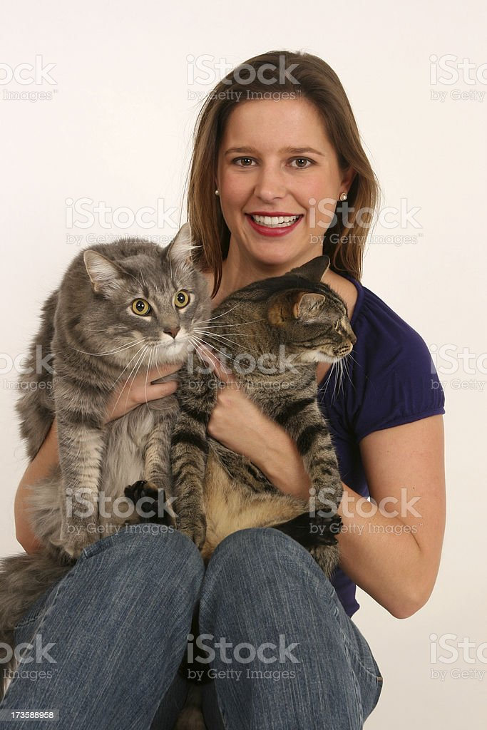 Attractive woman holding her 2 cats royalty-free stock photo