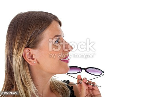 istock Attractive woman holding her sunglasses - isolated 835856456