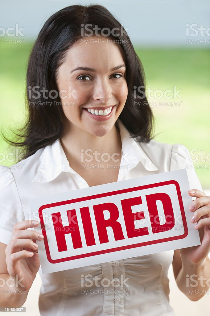 Attractive woman holding hired sign stock photo