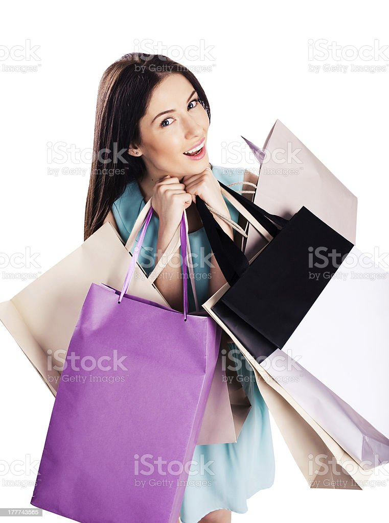 Attractive woman holding shopping bags royalty-free stock photo
