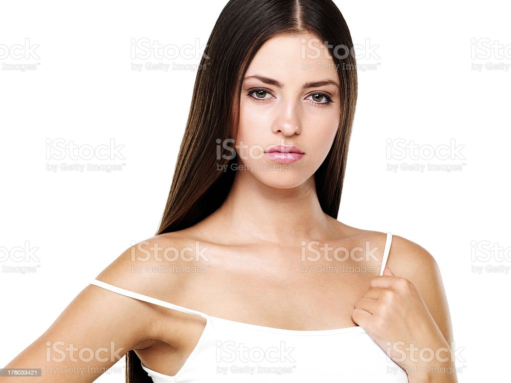 Attractive woman holding strap of her spaghetti top stock photo