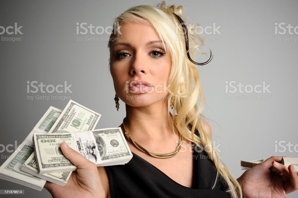 Attractive woman holding US dollars stock photo