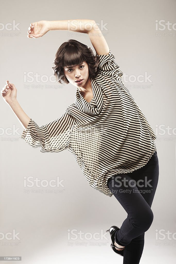 Attractive Woman in a Striped Top Dancing royalty-free stock photo