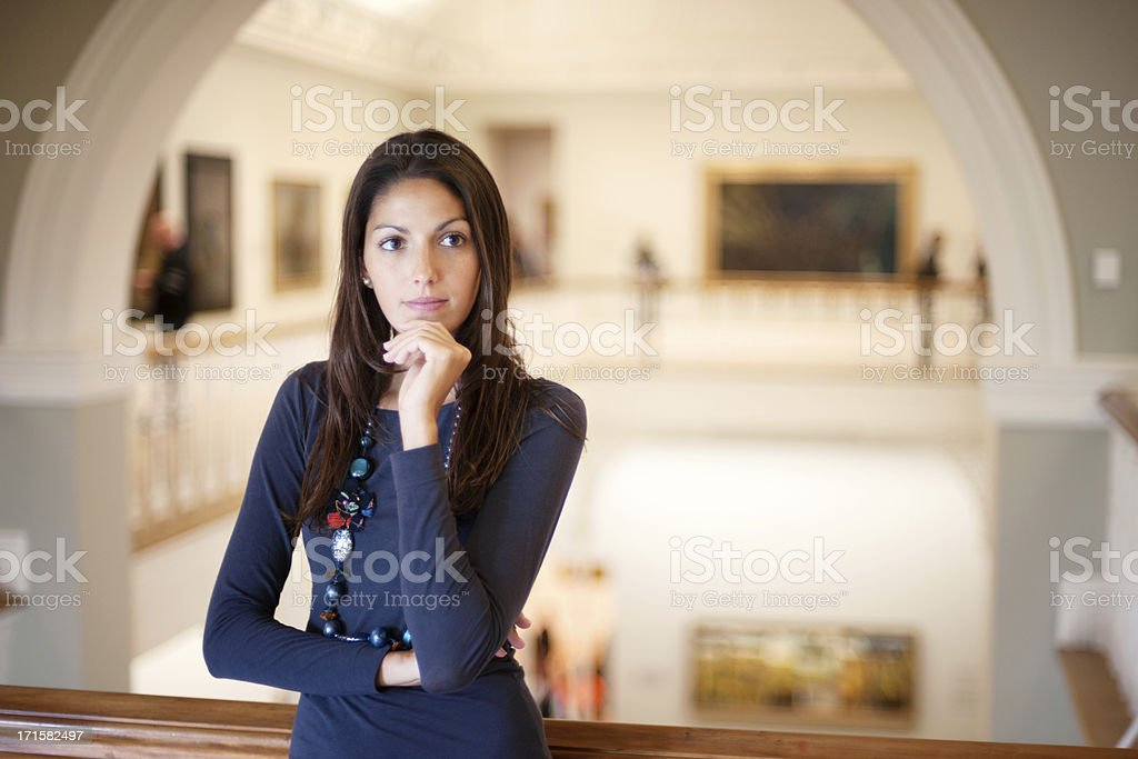 Attractive Woman in an Art Gallery stock photo