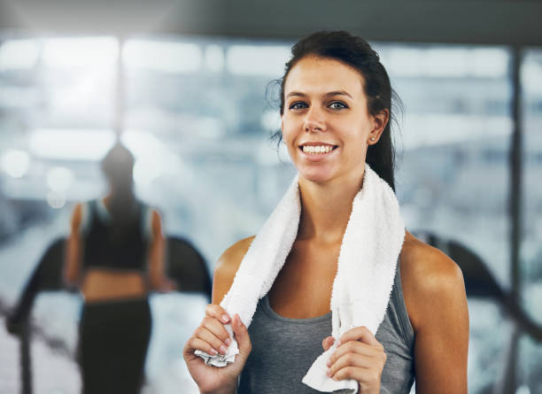 Attractive woman in gym gives a challenging smile stock photo