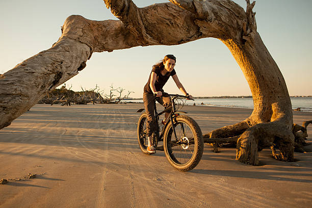 Attractive woman in her 30's riding on the beach stock photo