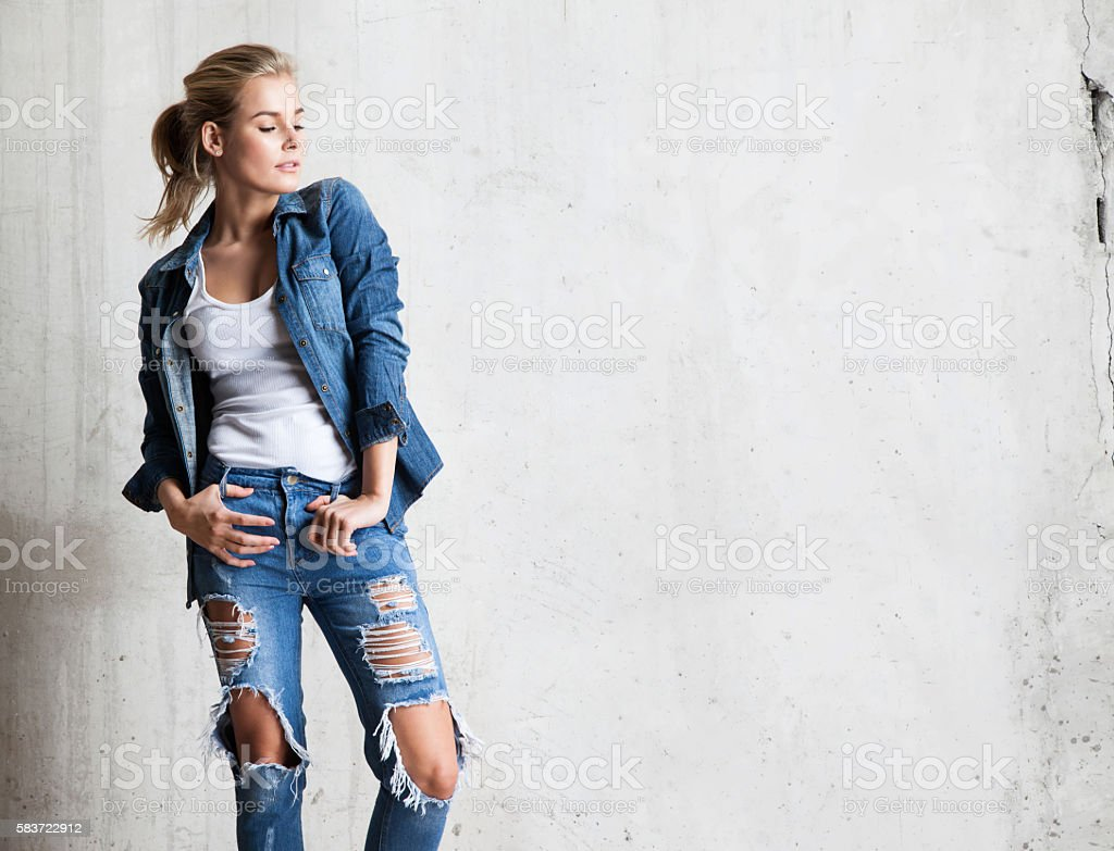 Attractive woman in jeans with blond hair stock photo