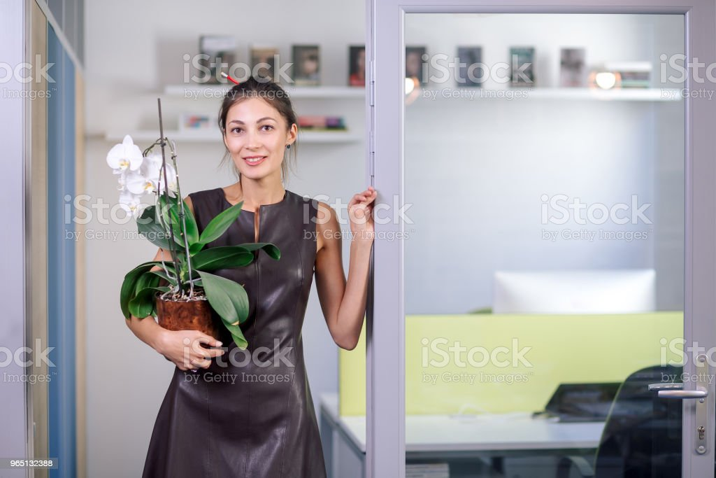 Attractive woman in leather dress moving in new office royalty-free stock photo