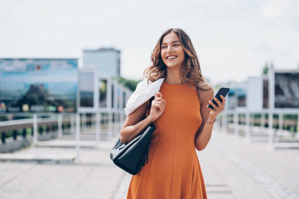 Attractive woman in the city stock photo