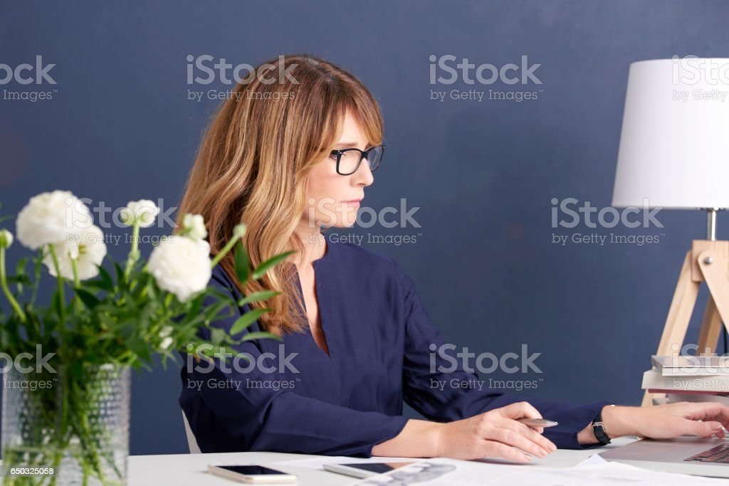 Attractive woman in the office stock photo