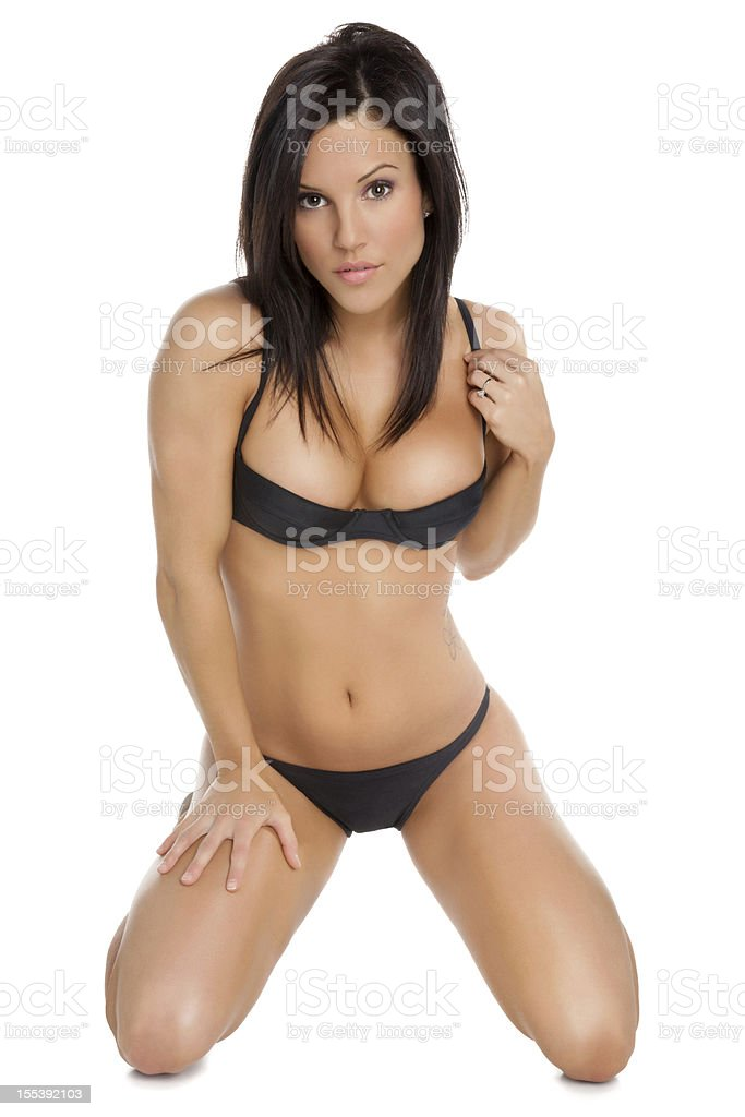 Attractive Woman Kneeling in a Bikini stock photo