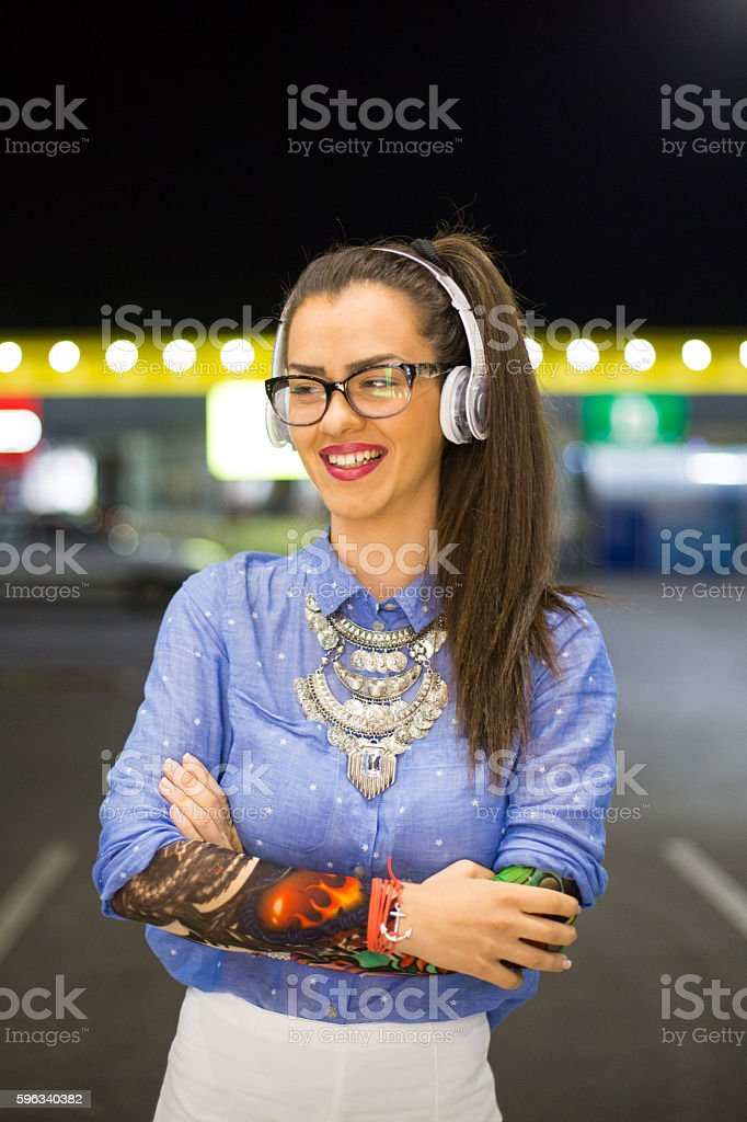 Attractive woman Listening to Music on Headphones royalty-free stock photo