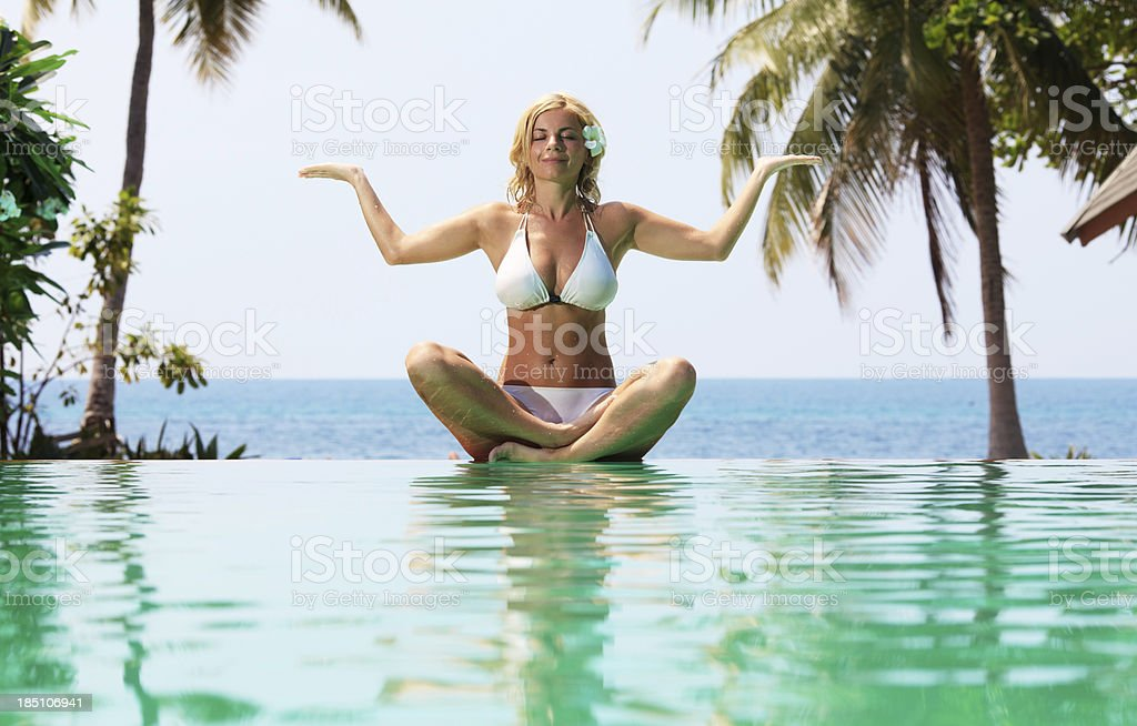 Attractive woman meditating on the beach. royalty-free stock photo