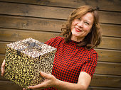 Attractive woman of  middle age with a gift box