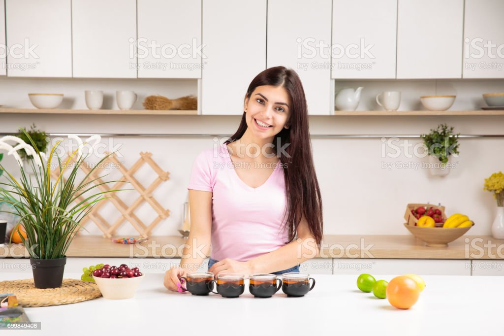 Attractive woman offering tea stock photo