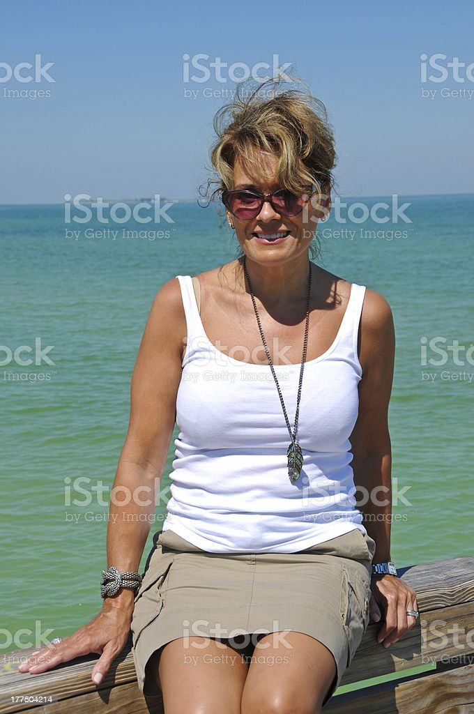Attractive Woman on Beach Boardwalk stock photo