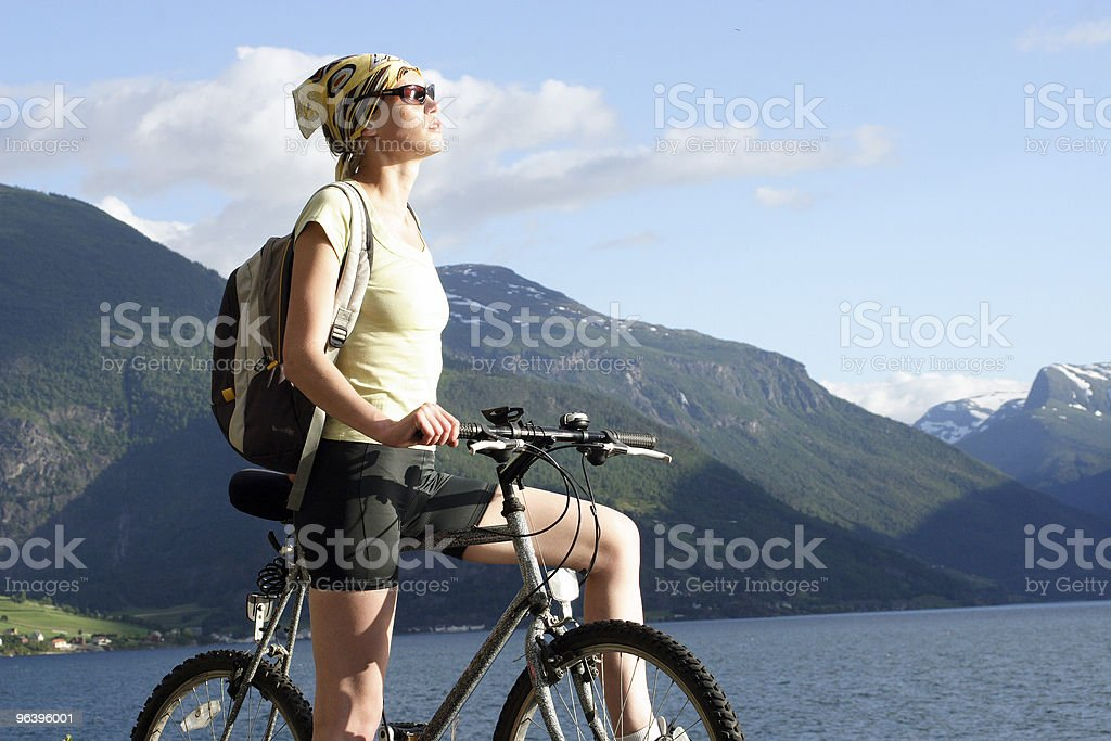 Attractive woman on the bike - mountains stock photo