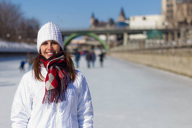 Attractive woman on the Ottawa Rideau Canal Skateway during wint stock photo