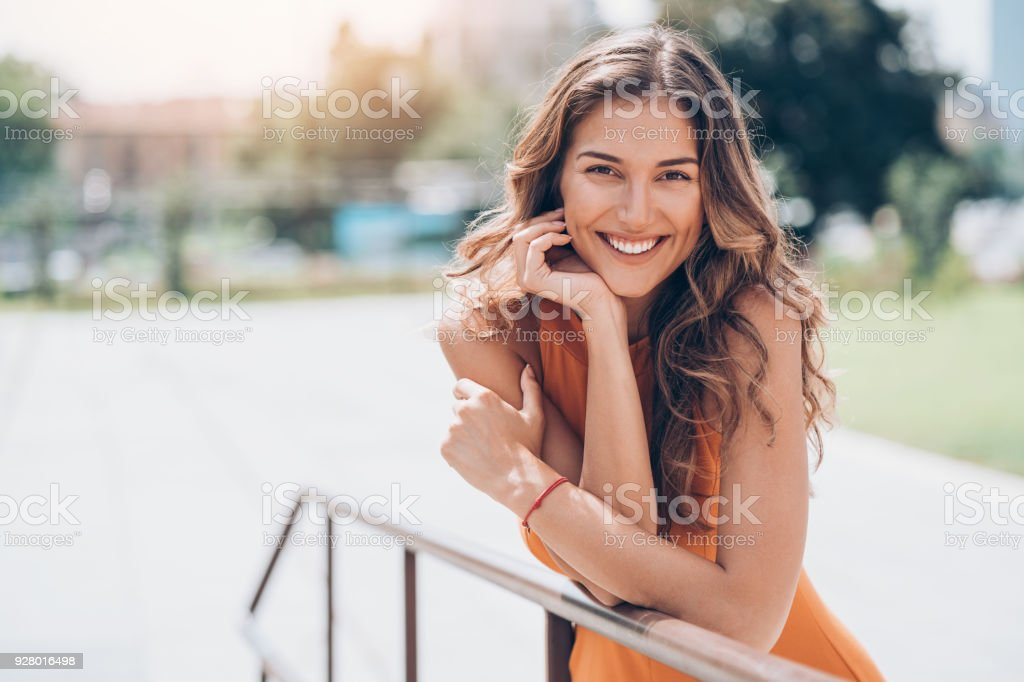 Attractive woman outdoors at sunlight stock photo