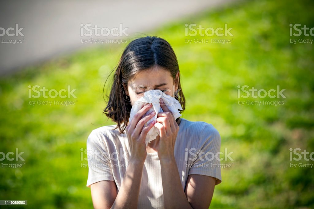 Woman Blowing Her Nose With Handkerchief In Public Parkf. Sick Young...