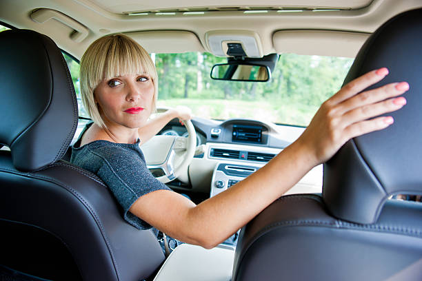 attractive woman parking her car stock photo