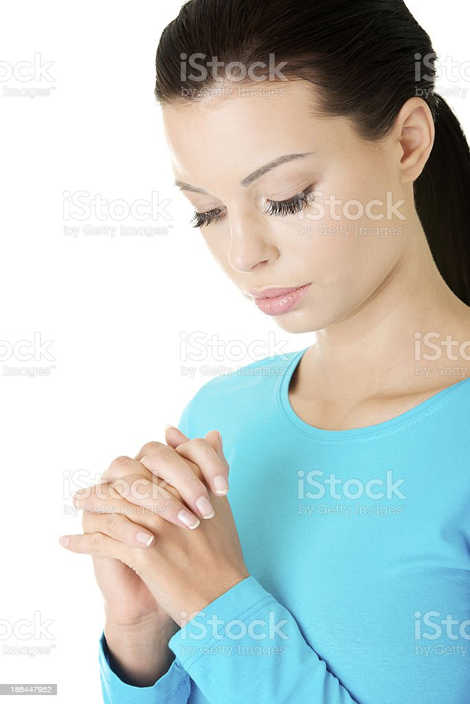 Attractive woman praying. Closeup. royalty-free stock photo