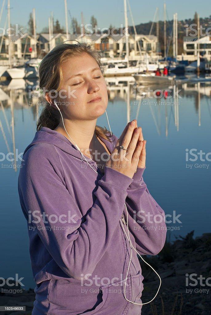 Attractive woman praying near marina royalty-free stock photo