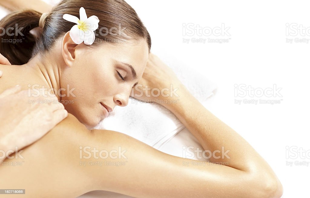 Attractive woman receiving shoulder massage at spa royalty-free stock photo