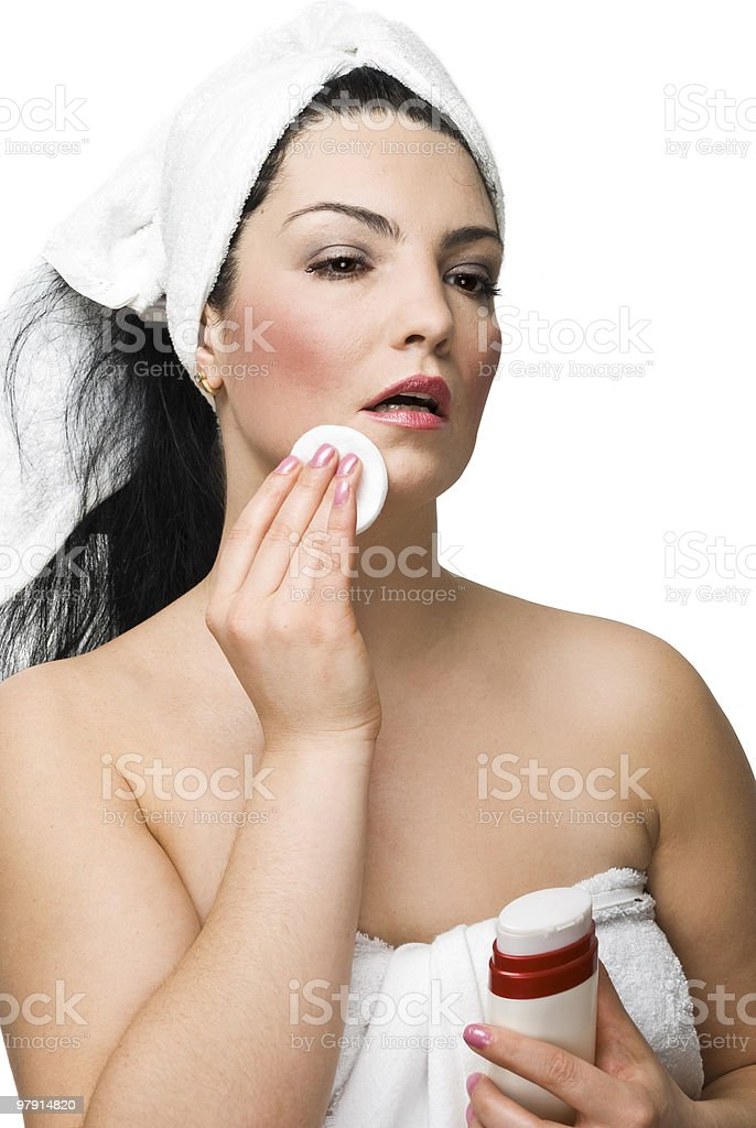 Attractive woman removing make-up royalty-free stock photo