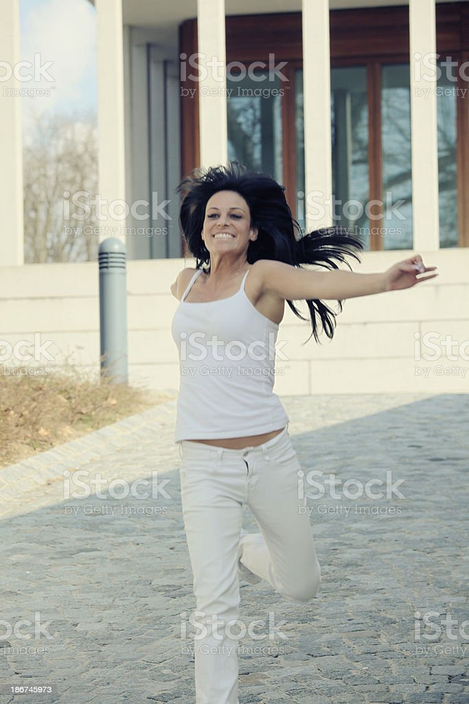 Attractive woman running royalty-free stock photo